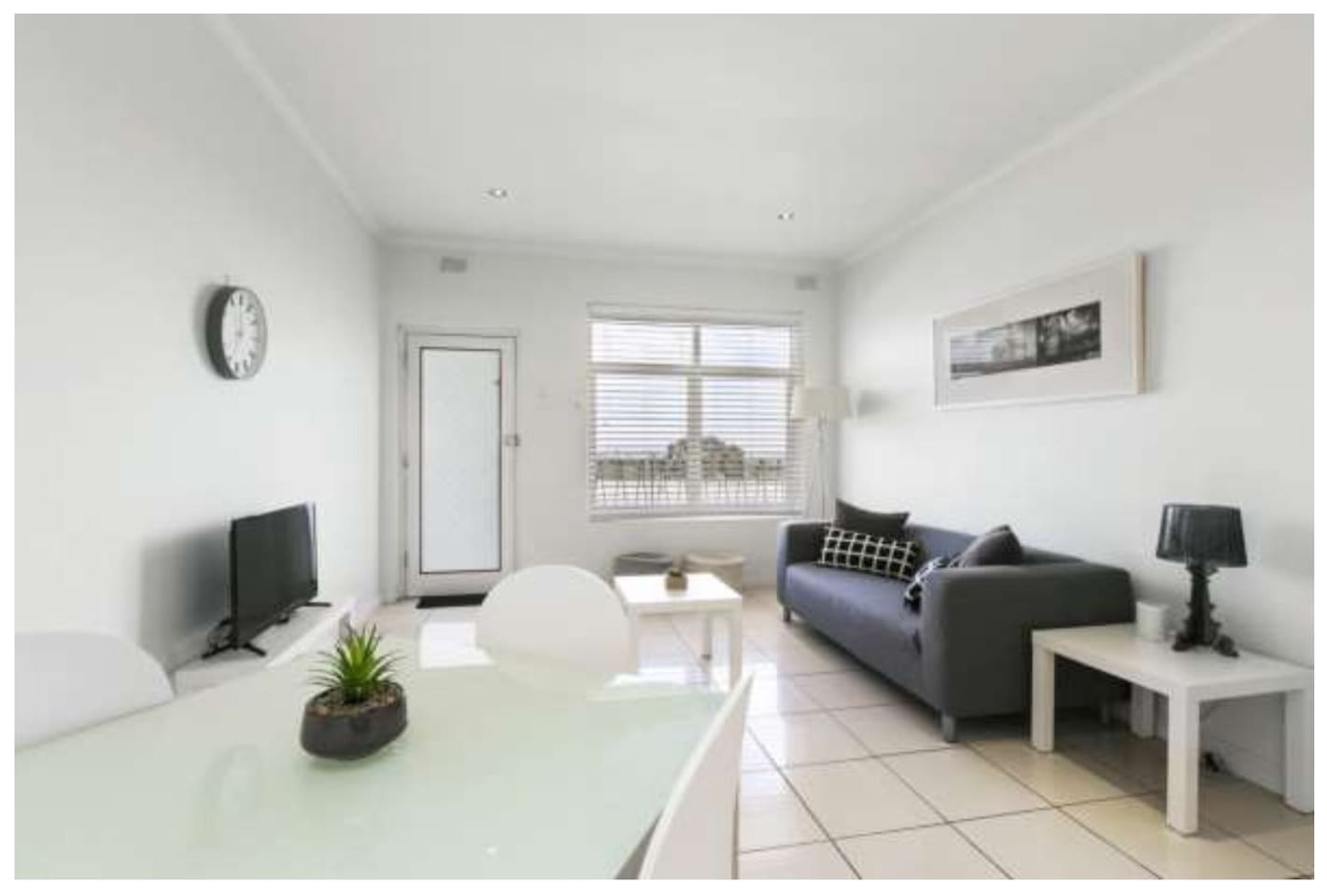 Fresh, Modern and Spacious living room with wonderful views of the City and most beautifully the evening Sunset.