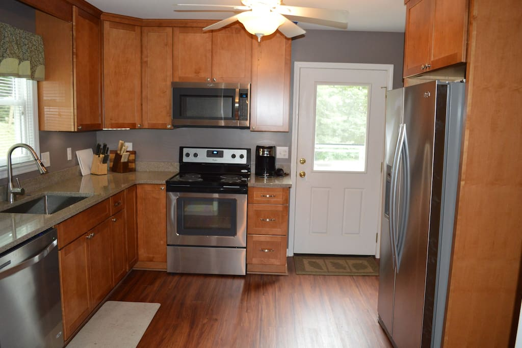 Fully Remodeled Kitchen. Stainless steel appliances. Refrigerator with indoor water and ice maker