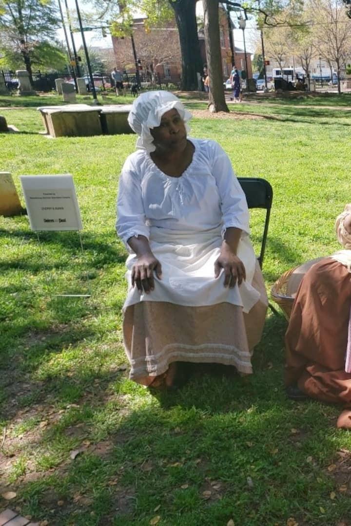 Reenactment of slaves buried in cemetery