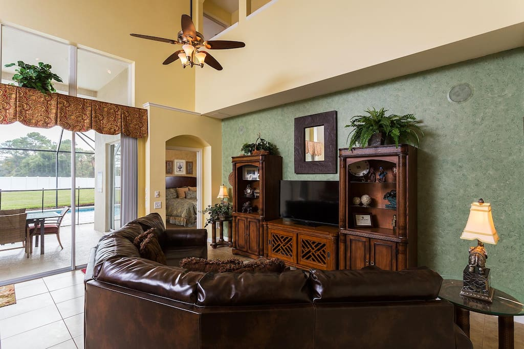 Watch TV in the living area with 51-inch plasma TV, surround sound stereo system and DVD player