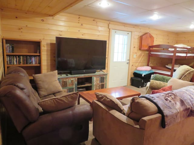 Fully finished basement with entertainment center, bunk beds, full bathroom and access to deck.