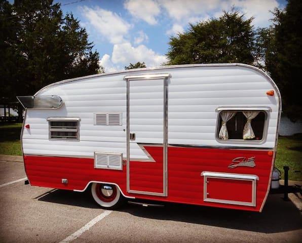 The Flying Ham Camper Rentals- 16ft red ham