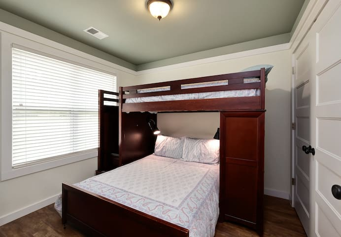 The second bedroom has a full bed and upper twin bed and large closet.