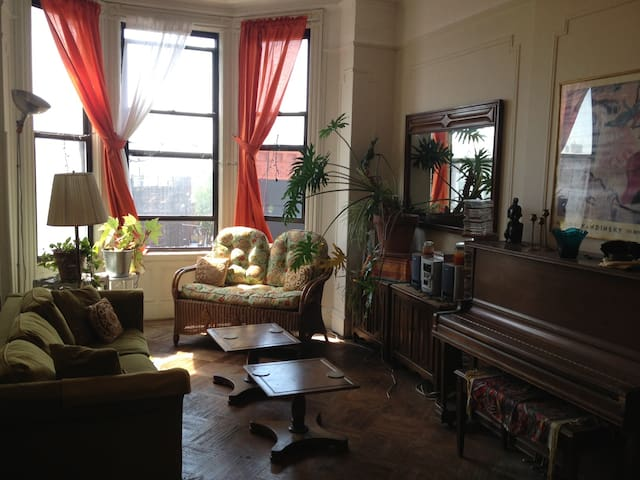 Airy Room - large apartment - lively neighborhood!