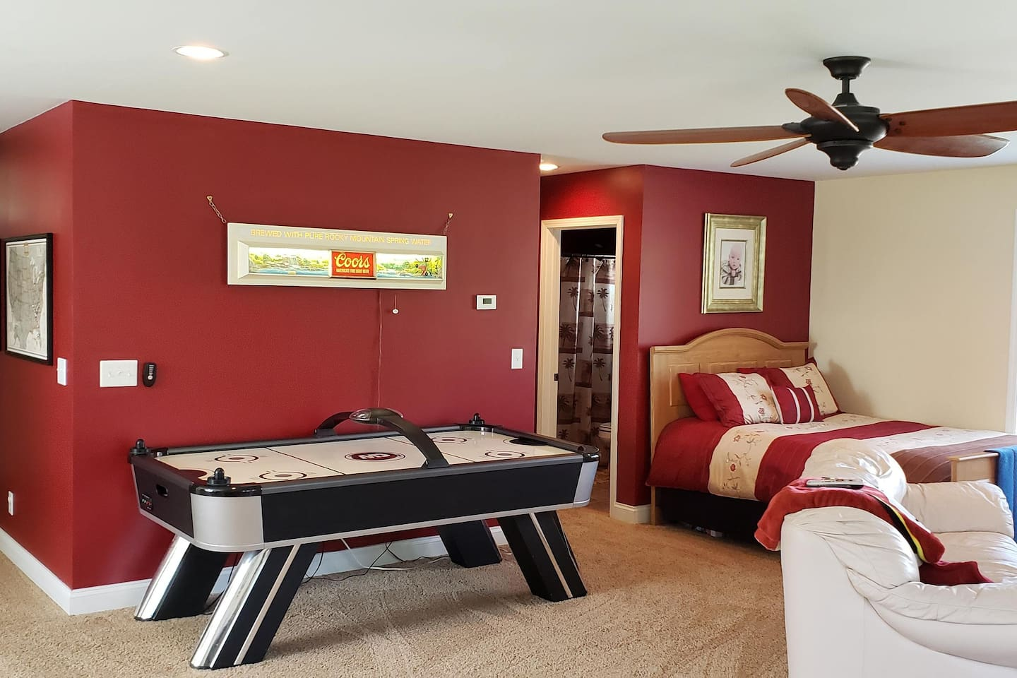 Large private room with full bathroom (shower/tub), couch, recliner, satellite t.v., ceiling fan, table games, and your own thermostat - separate from the rest of the house.