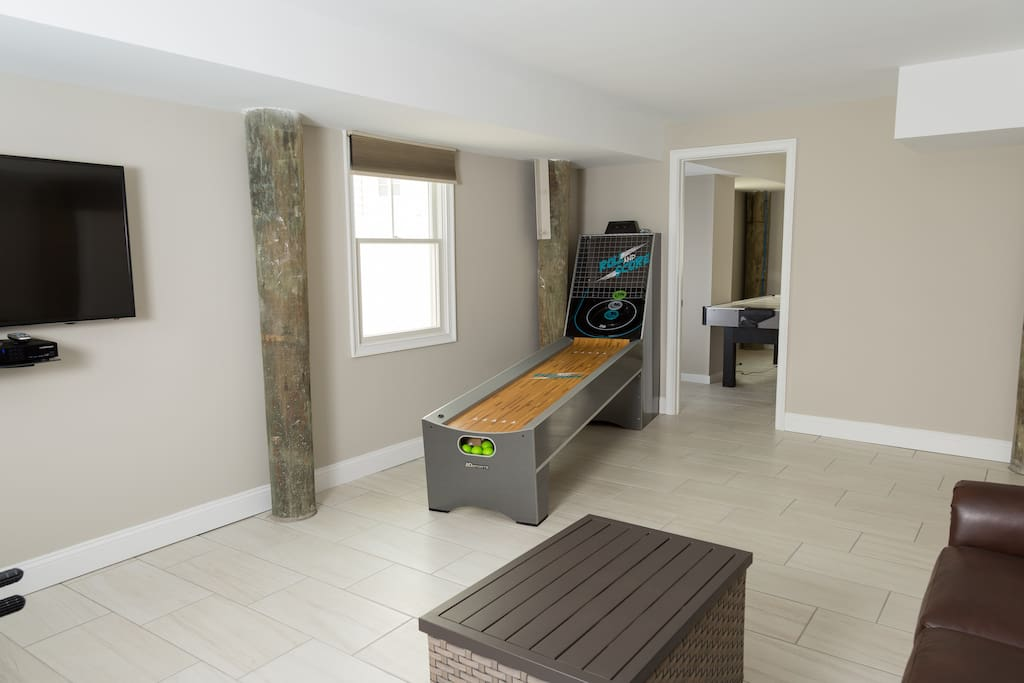 Game room with skee ball, air hockey and foosball