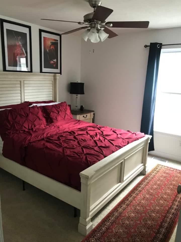 Spacious guest bedroom in a quiet neighborhood.