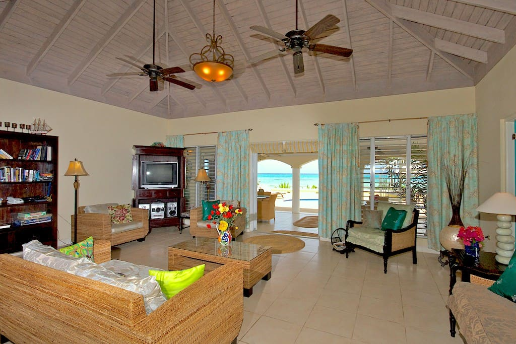 Living Room opens to the Patio, Pool Deck, and the Caribbean Sea