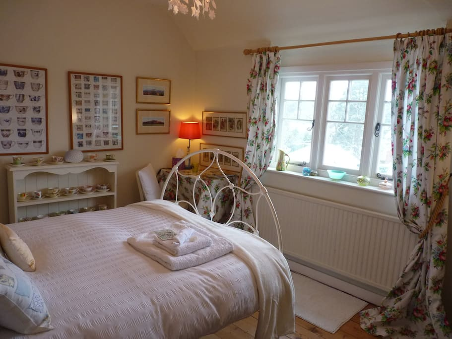 the guest bedroom with elevated views over the village.