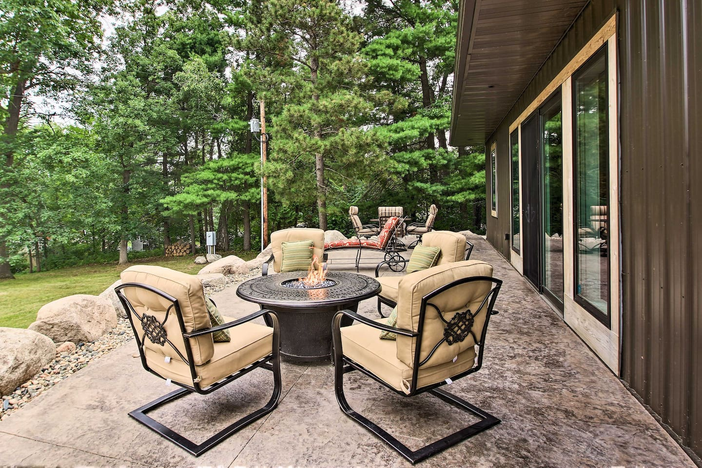 This vacation rental's patio features comfy furniture with a gas fire pit.