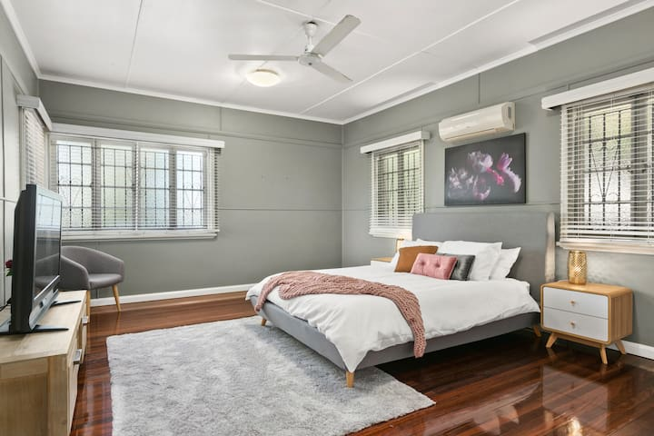 Spacious Master Bedroom with Queen Bed, TV and wardrobe