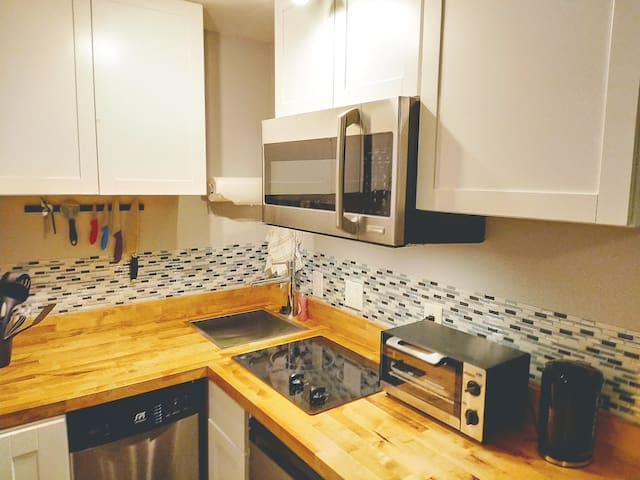 Fully equipped mini kitchen.  Microwave doubles as convection oven.