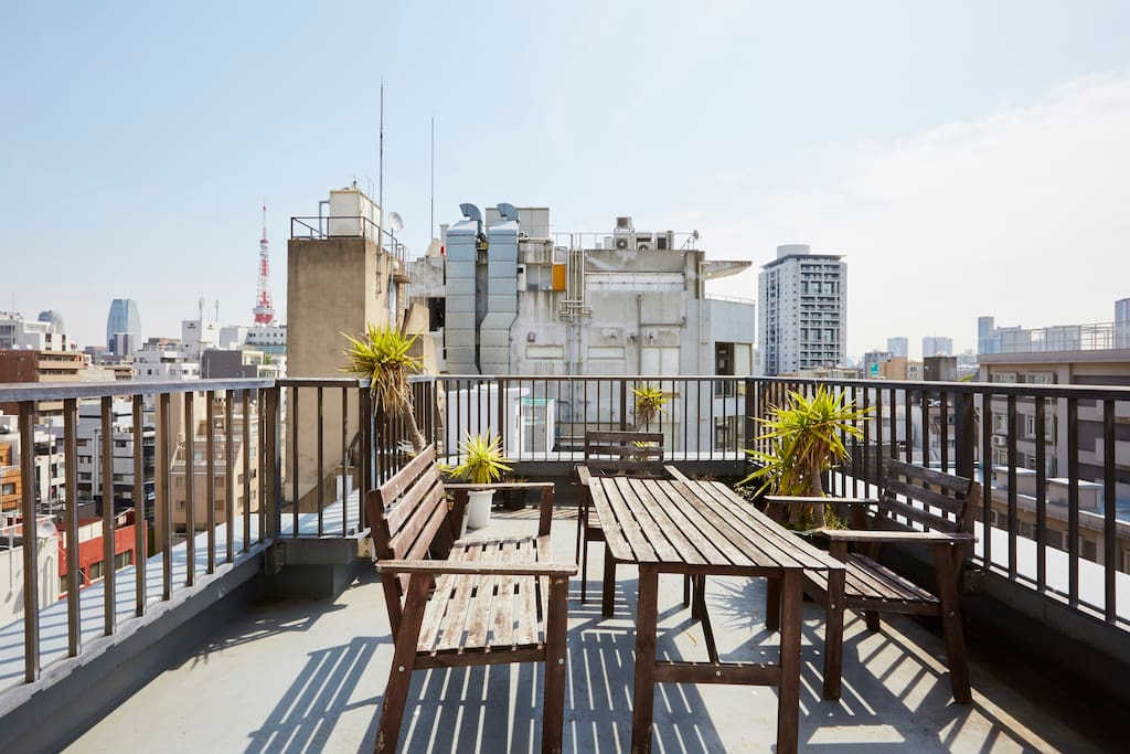 Massive rooftop balcony overlooking the city in all directions, including a view of Tokyo Tower.