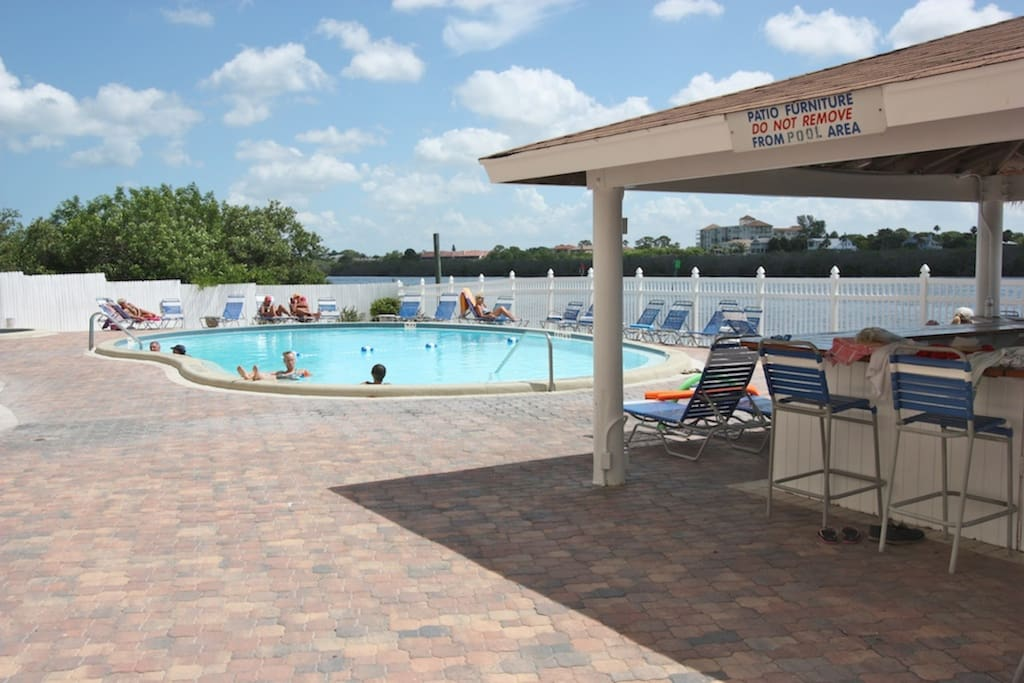 Communal Heated Pool with Covered Bar Area Overlooking The Intercoastal