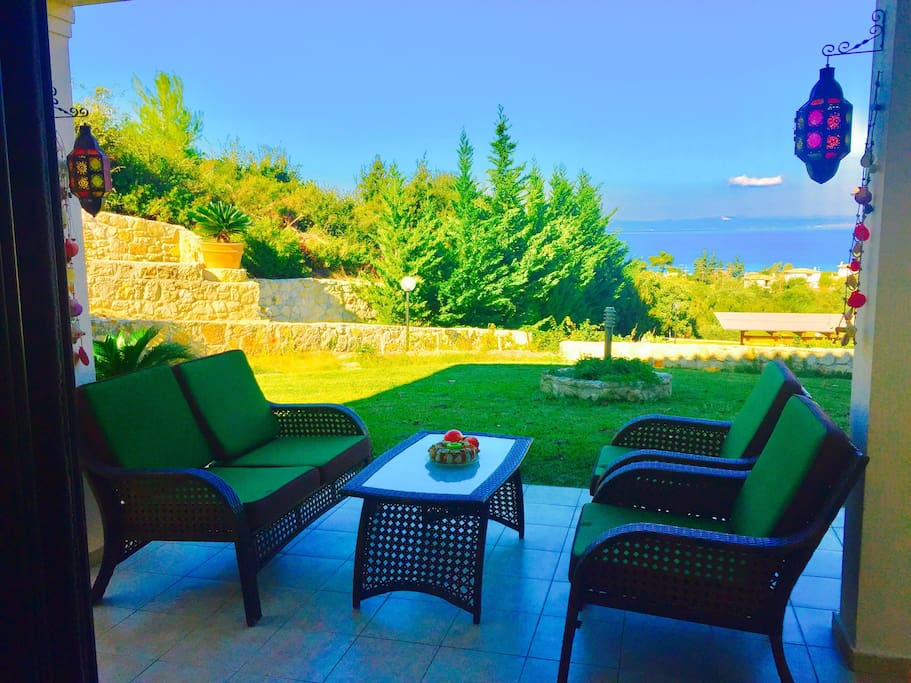 The  in frond outdoor living area with garden and sea view!
