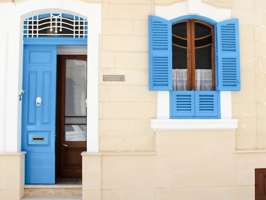 TYPICAL MALTESE TOWNHOUSE WOODEN FRONT DOOR AND SHUTTERS