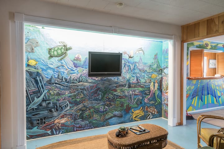 Island Guest House check-in and flat screen TV located in Lobby.