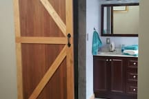 Barn door leading into the bathroom