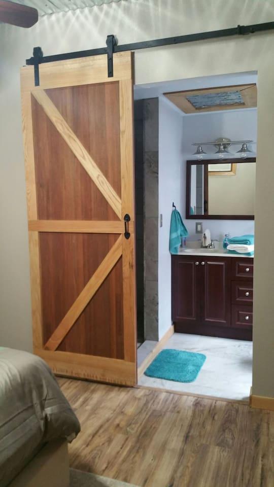 Barn door leading into the bathroom