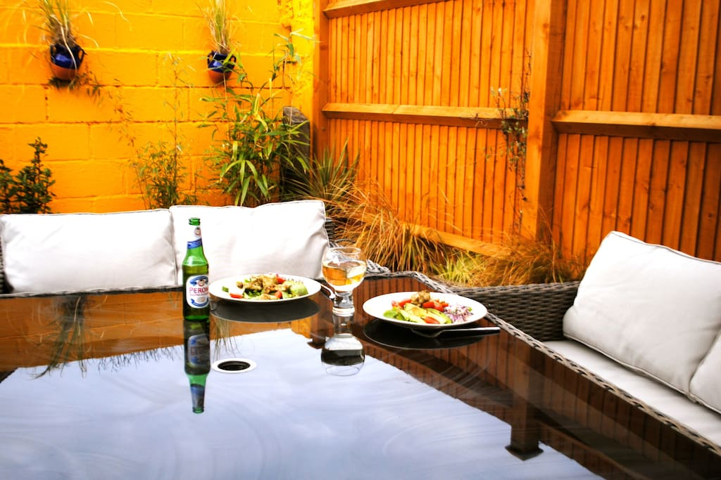 Al fresco dining in the Meditteranean style sunny courtyard garden