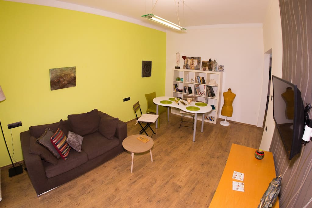 Living room has a wood floor and direct access to the bedroom, kitchen and balcony of the apartment. Flat tv available and fast wifi