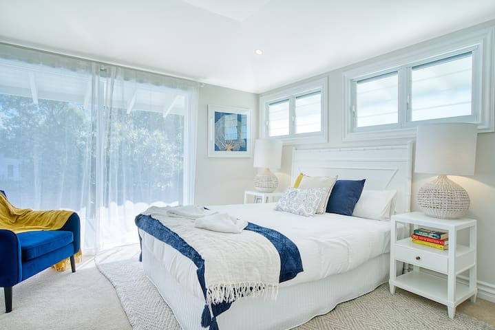 The second bedroom upstairs benefits from a premium queen-sized bed, dressing room, ensuite bathroom and private balcony with beautiful views.