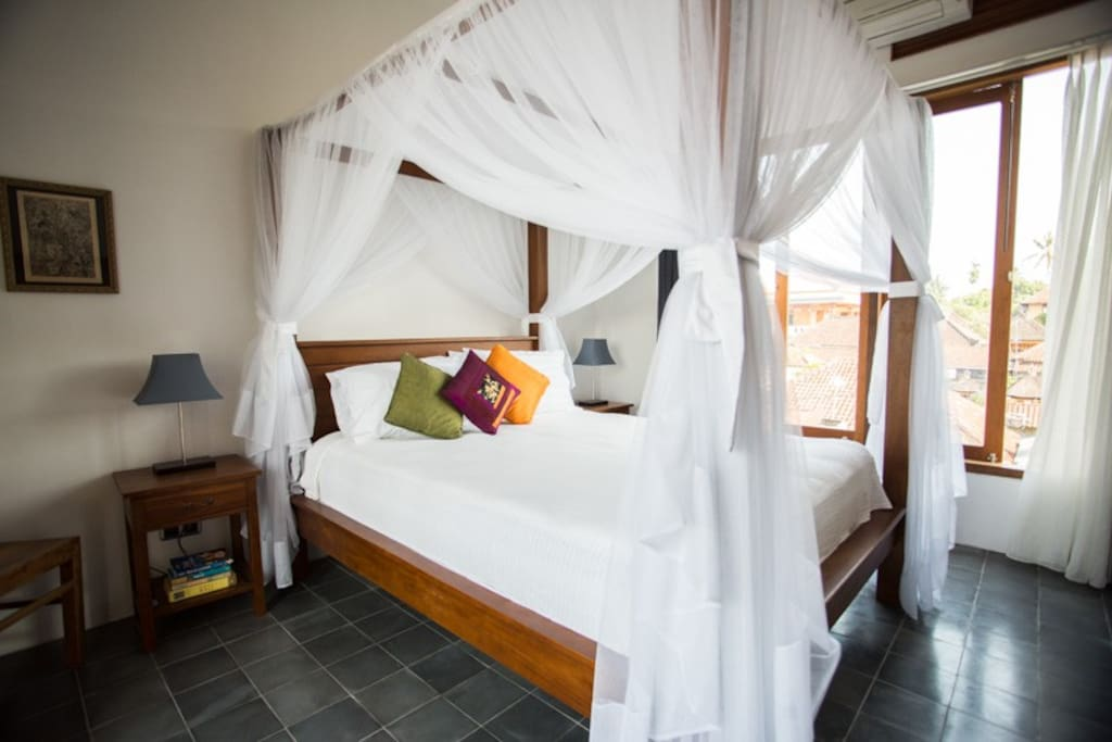 Four poster teak beds with mosquito nets