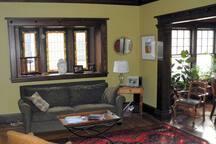 Comfy, shared living room, filled with original artwork.