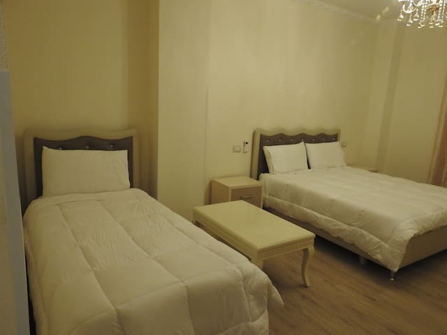City-view room for 3 persons, bathroom, smart TV, air conditioning, fridge, free wifi, wardrobes and balcony