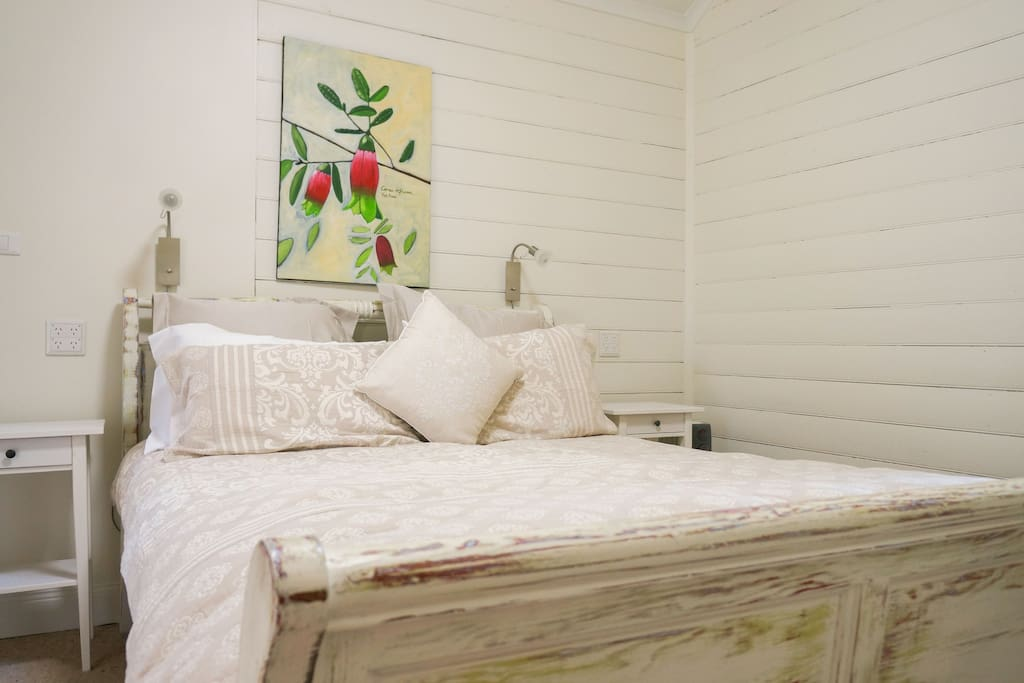 Queen sized bed with thick pillow mattress and Continental quilt and cushions