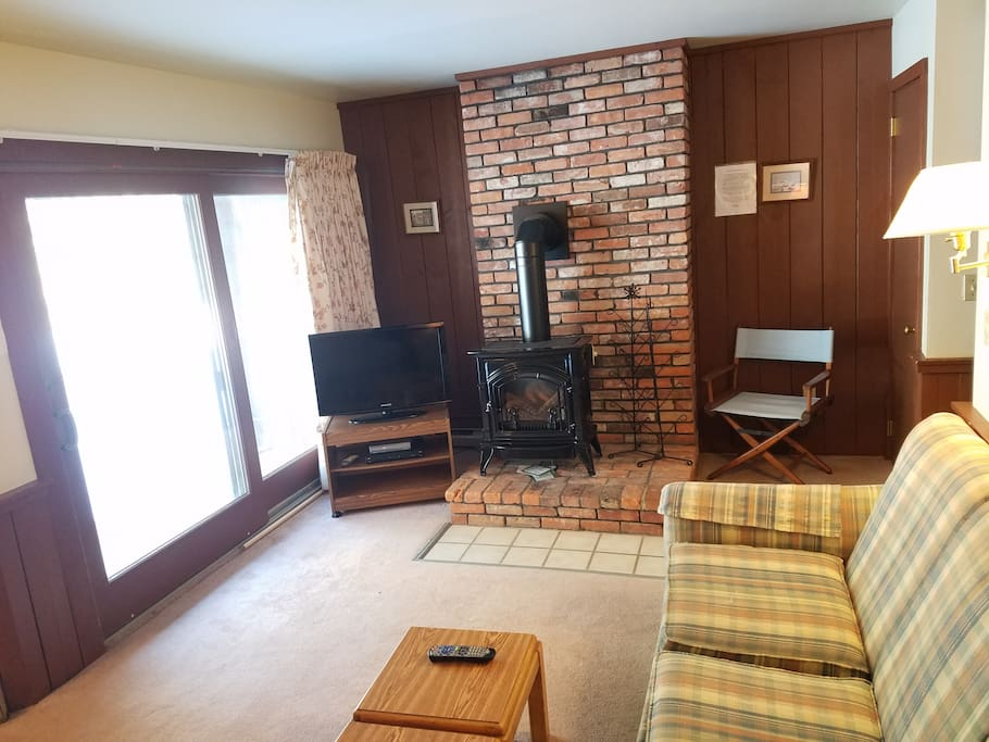 Enjoy the gas fireplace and watch skiers pass by the slider glass window