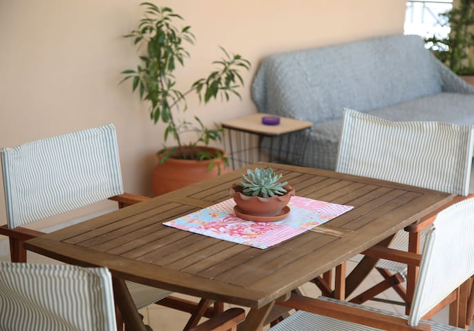 Big terrace with outdoor furniture