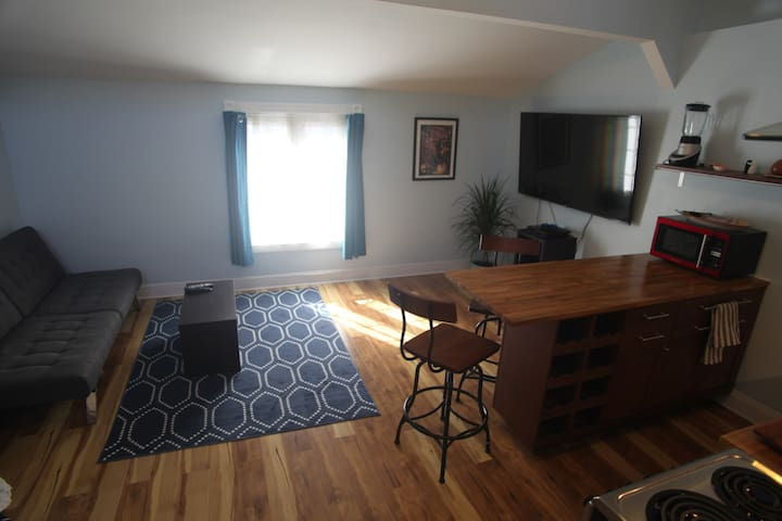 Relax and enjoy the entertainment center and kitchen