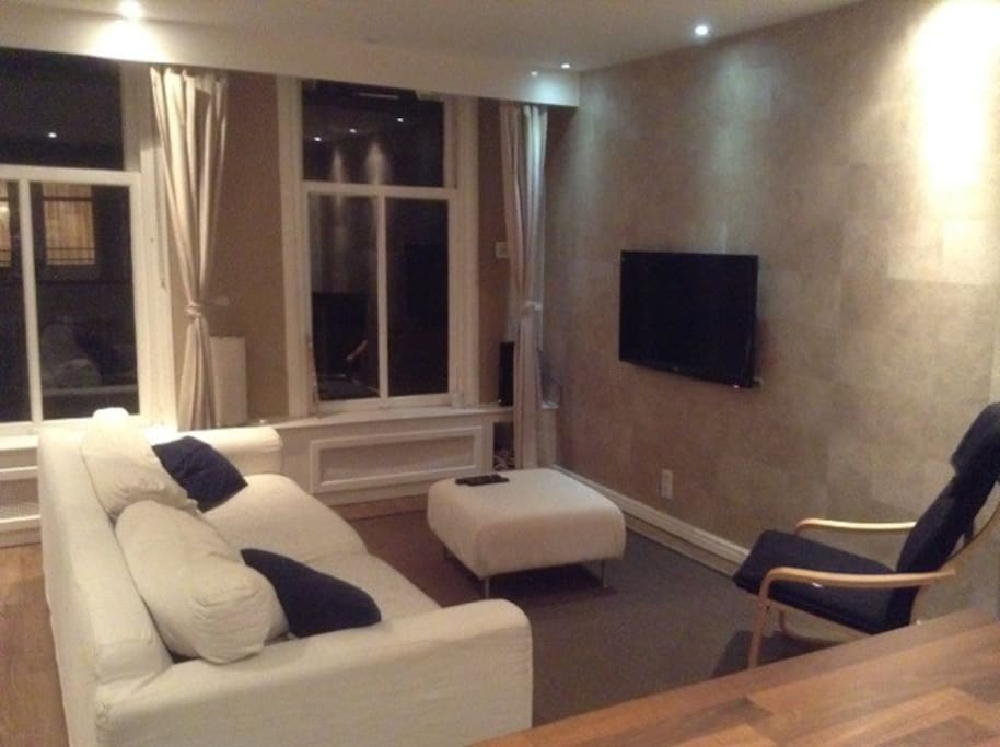 Lounge, large comfy sofa, big TV.  Downstairs has kitchen, full bathroom, lounge and dining room.