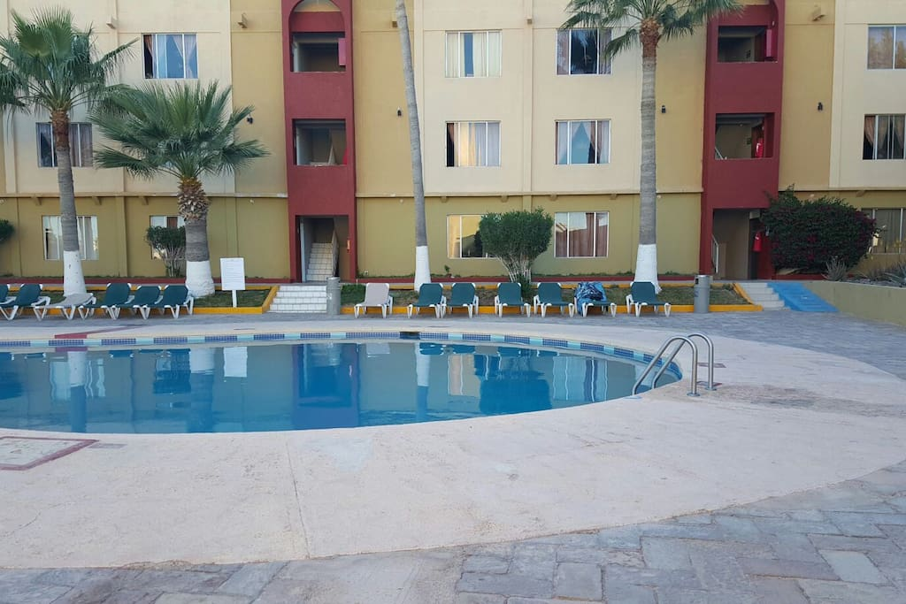 Condo is located just in front of the swimming pool.