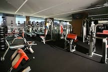 Complimentary access to fitness center overlooking strip with cardio and weights
