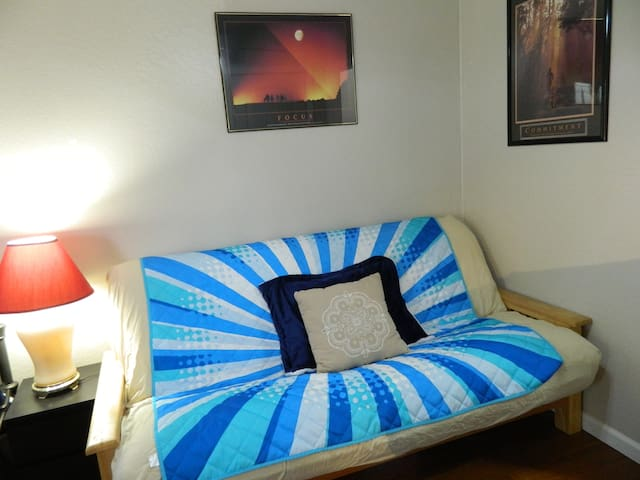 Sofa-futon up-close.  Note: the lamp is replaced with the beige lamp to better match the color scheme of the room