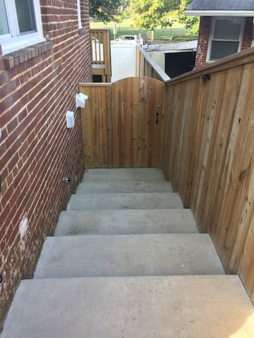 Stairs leading down to secure gate