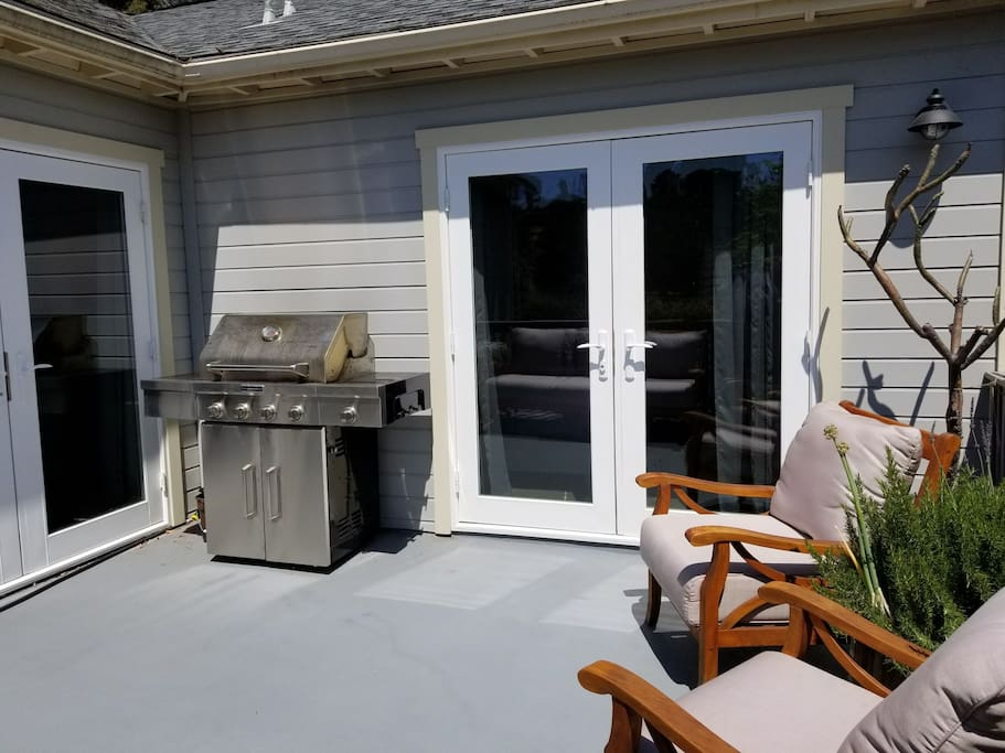 The outdoor living area has a gas bbq, furniture and great views.