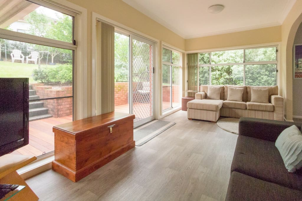 Sunny rear living room (one of two), opens to deck & garden