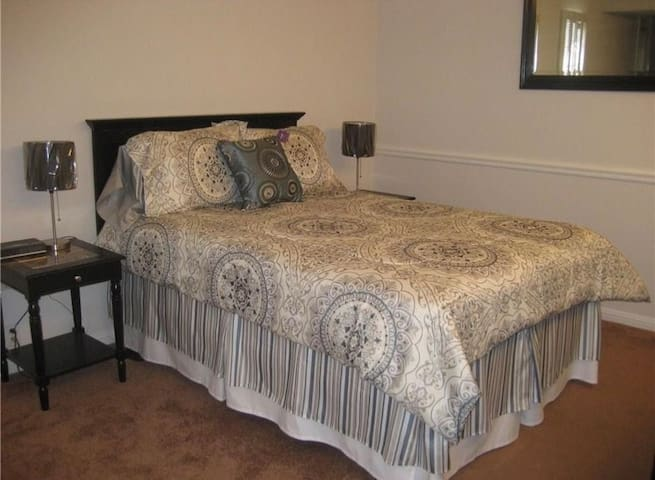 There is one queen sized bed. Additional queen air mattress available to accommodate a third guest.