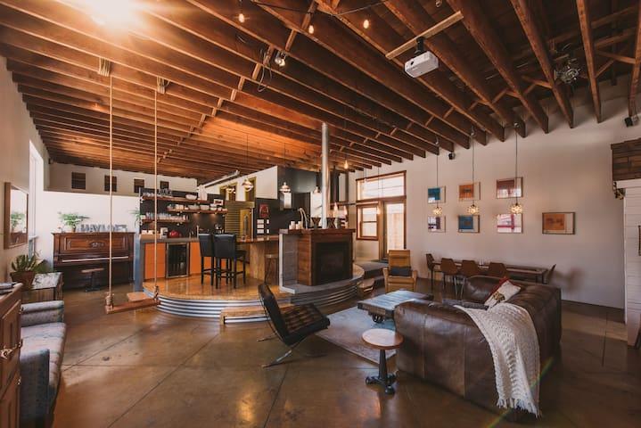 Open, elavated kitchen space wrapped in corrugated steel like a true prairie Westeel Rosco grain bin.