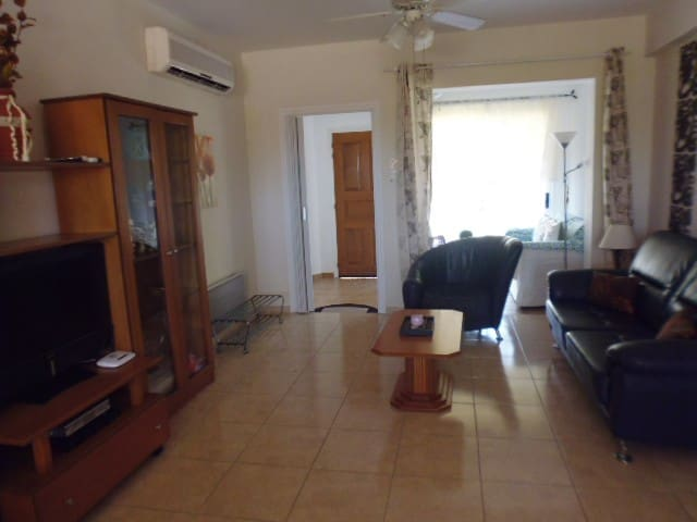 Living room with leather sitting furnitures. LG flat tv, dvd player. Sat-tv.
