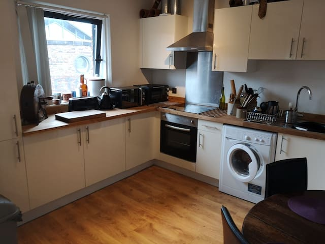 Beautiful kitchen, your very welcome to use the mini oven and microwave, and help yourself to coffee or tea