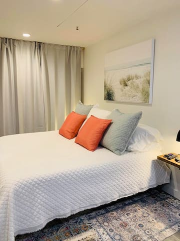 Serene & comfy bedroom area w/ blackout curtains