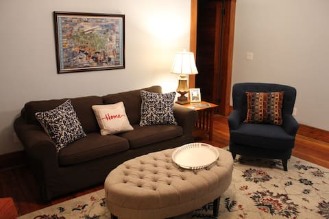 The living room includes a sofa bed with memory foam topper for extra comfort.