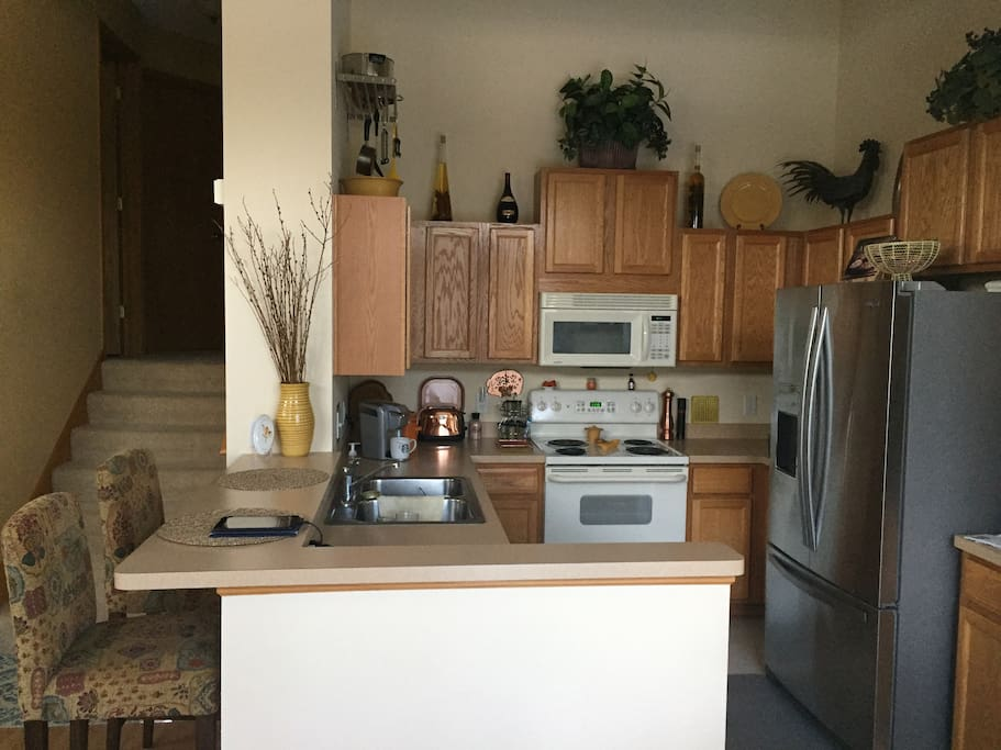 Kitchen is efficient and clean. All appliances work well and a Kurig is included. The refrigerator is open to you and is loaded with bottled water. From the kitchen you will be able to interact with your fellow travelers that are enjoying the living room.