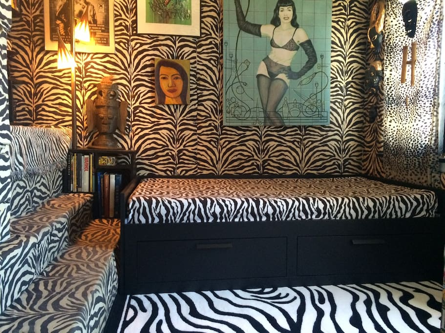 The most current photo of the zebra guest room with a bed that folds out into twice its size.