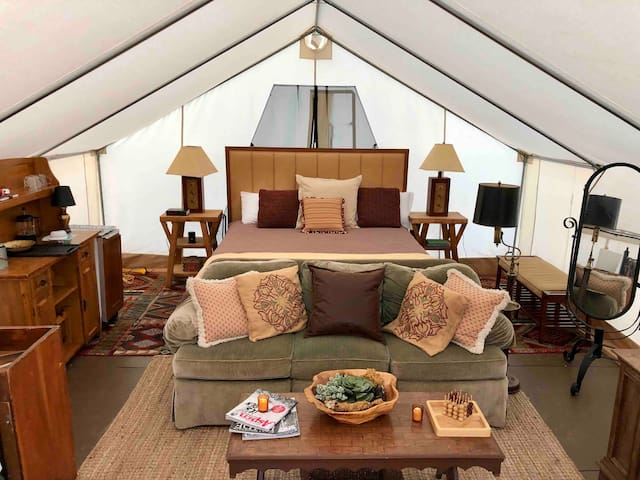 """Our """"stargazer tent"""" has a whole new interior design and a newly built deck. Special pieces from all over the valley. A king size bed and two trundle beds do it can sleep a group of 6."""