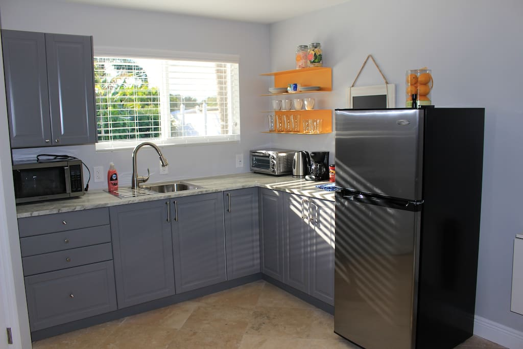 Kitchen with stainless steel refrigerator & microwave